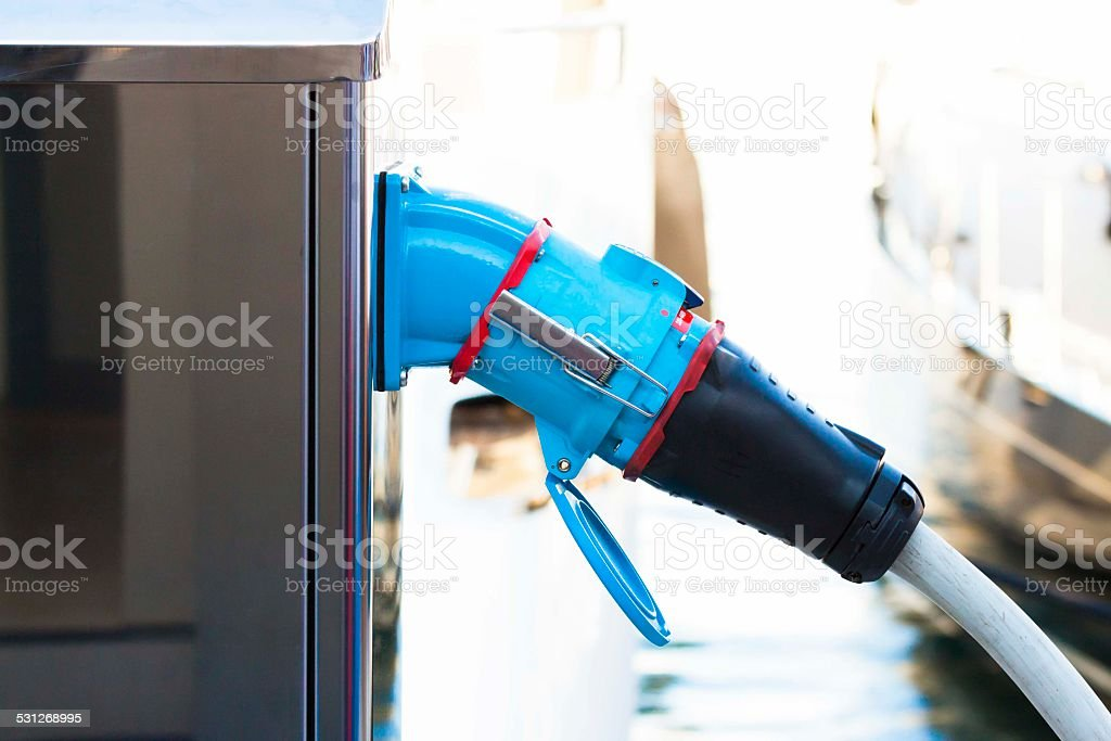 Electric power connection point for boats in marina stock photo