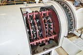 electric power generator brushing system