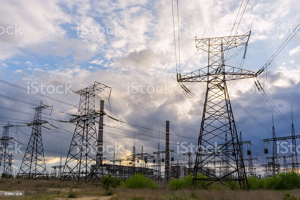 Electric power lines against sky at sunrise. stock photo