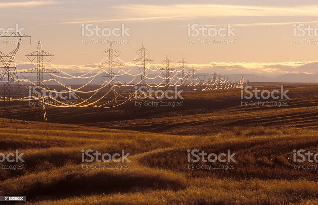 Electric Power Lines and Towers in HIlls stock photo