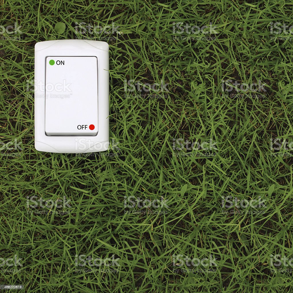 electric power switch on a green grass background royalty-free stock photo