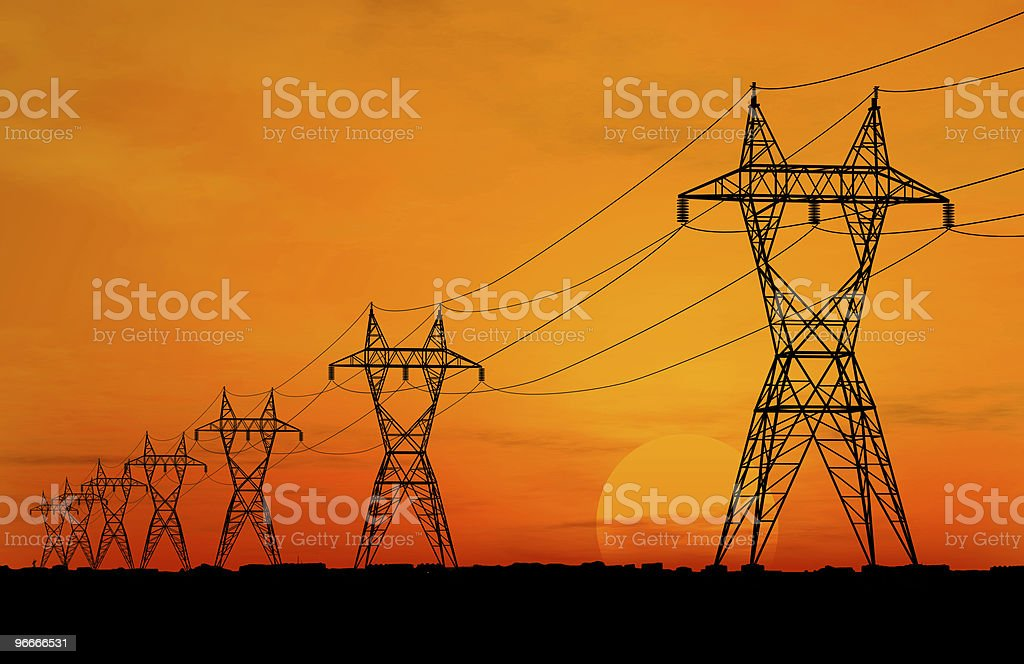 Electric power transmission lines over sunrise stock photo