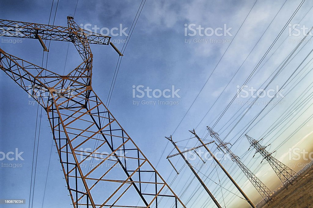 Electric power utility pole on cloudy sky royalty-free stock photo