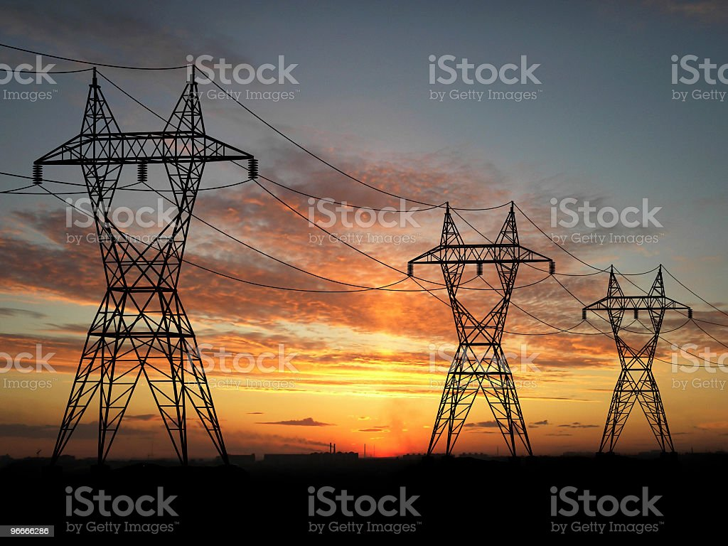 Electric powerlines over sunrise stock photo
