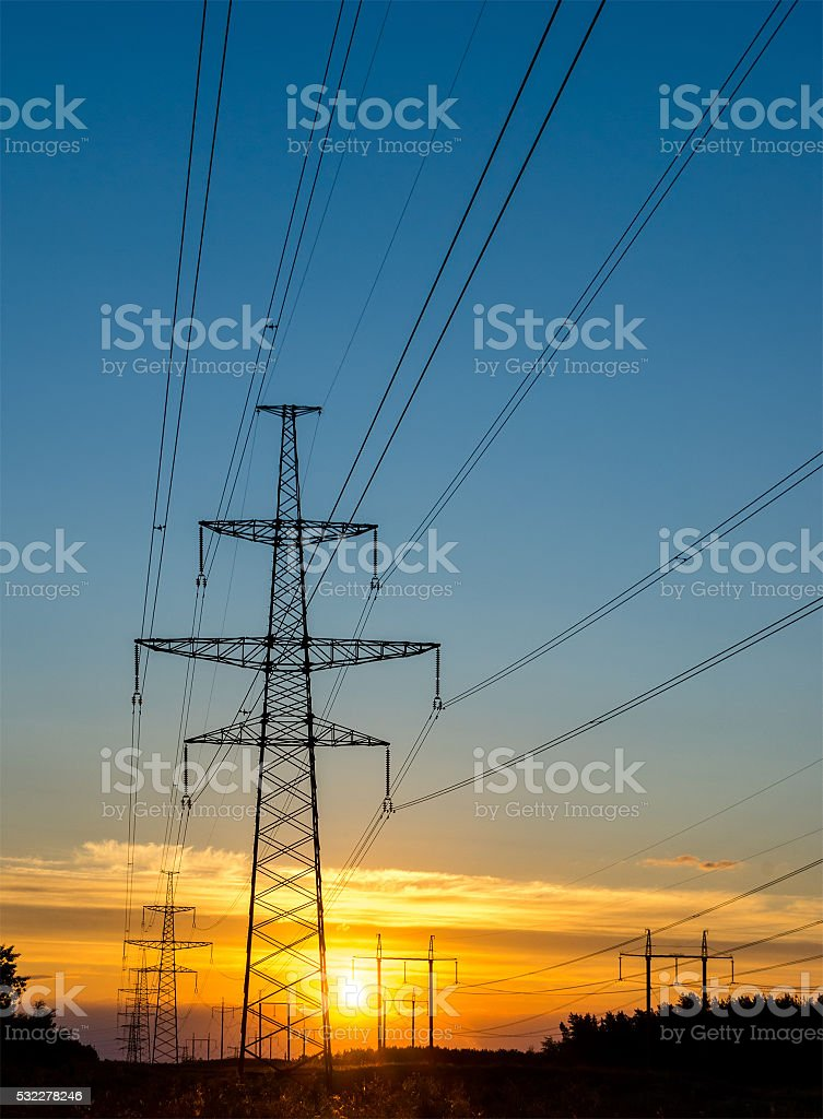electric pylon with power line at sunset stock photo