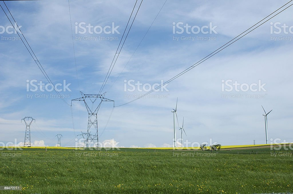 Electric pylons close to windturbines royalty-free stock photo
