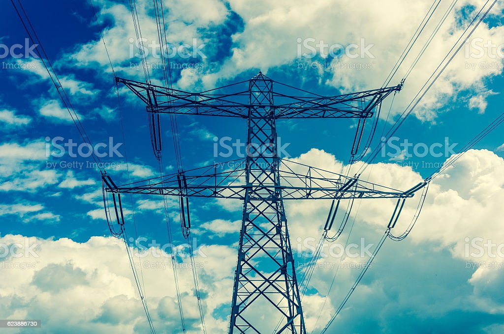 Electric pylons on the blue sky background stock photo
