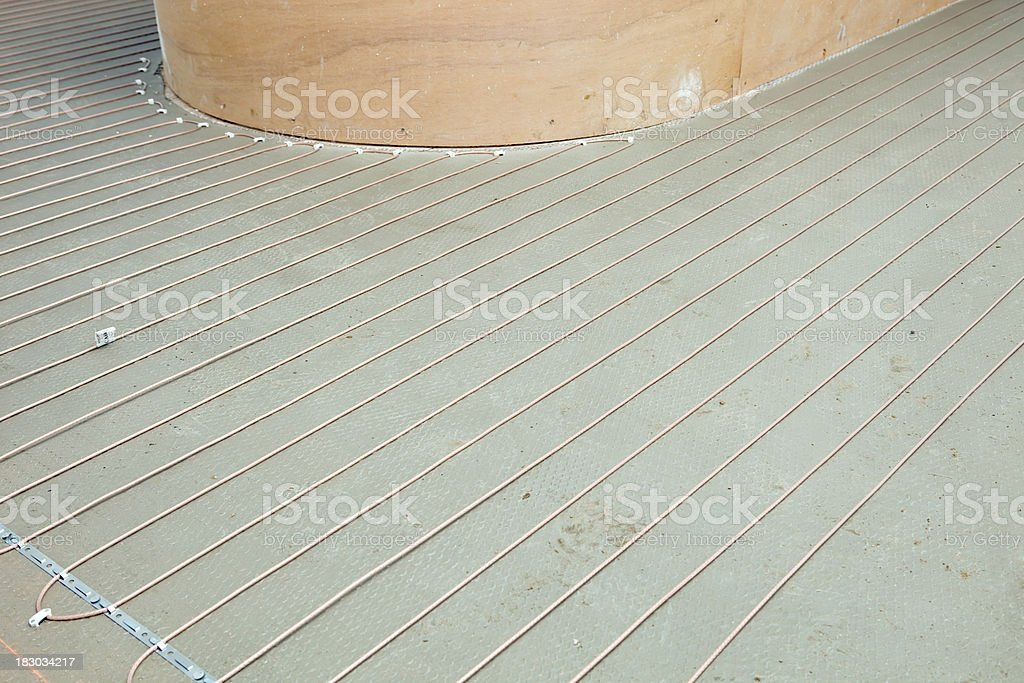 Electric Radiant Floor Heat Coils in a Bathroom stock photo