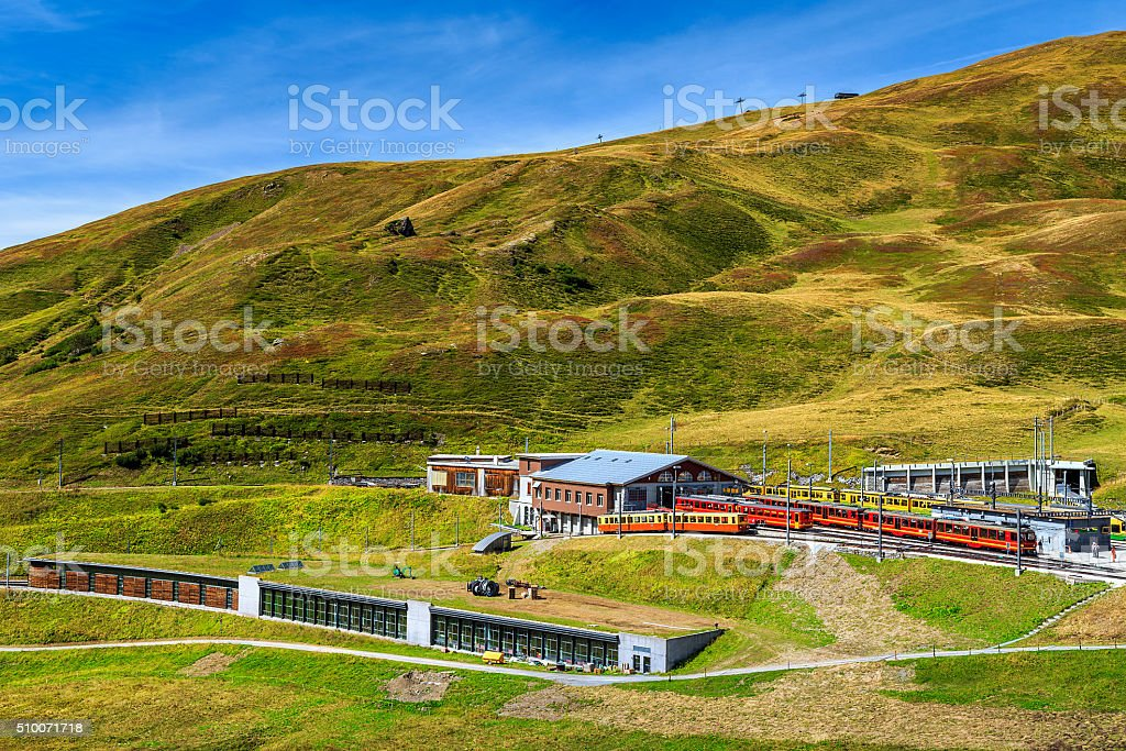 Electric red tourist trains in the station,Bernese Oberland,Switzerland stock photo