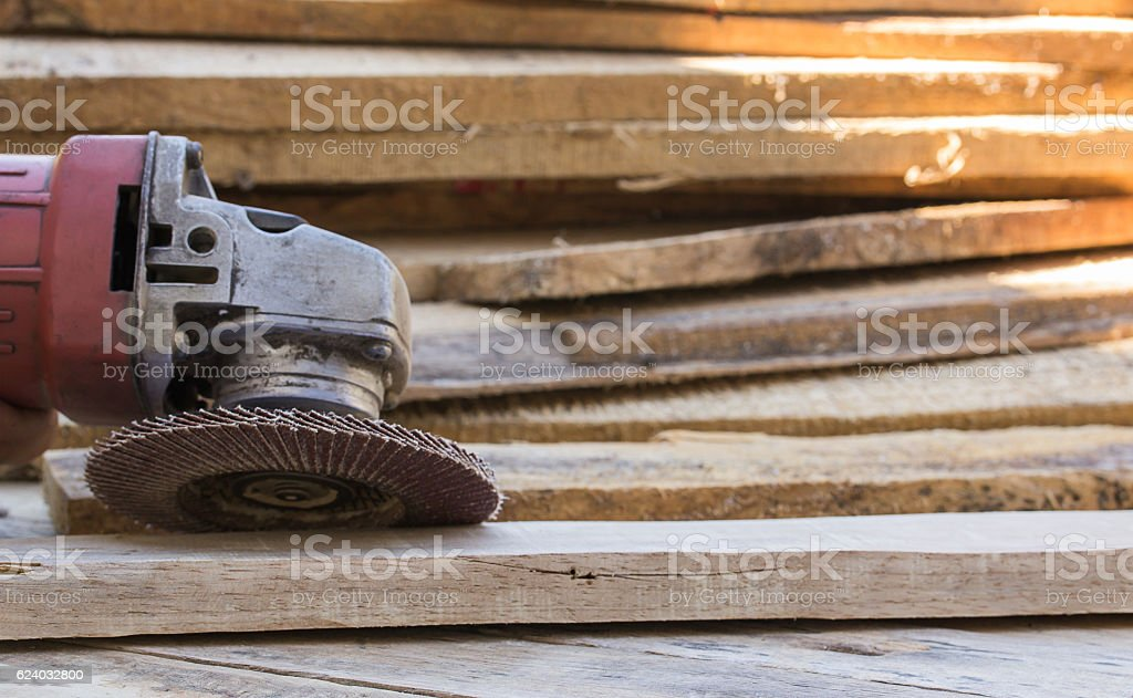 Electric sandpaper tool on wooden table stock photo