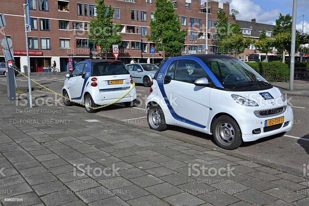 Electric Smart Fortwo cars on the parking and charging point stock photo