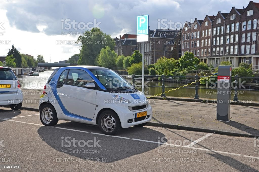 Electric Smart Fortwo on the parking and charging point stock photo