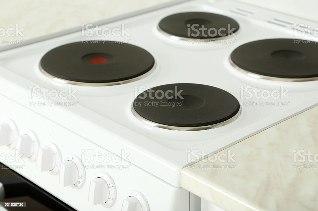 Electric stove in the kitchen, close up stock photo