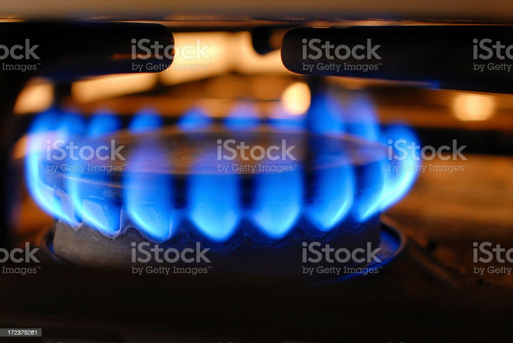 Electric stove on high heat burning blue flames stock photo