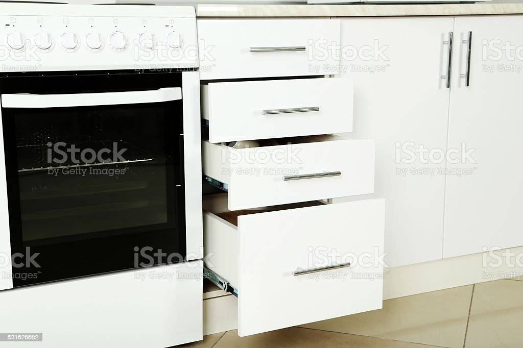 Electric stove  with boxes in the kitchen, close up stock photo