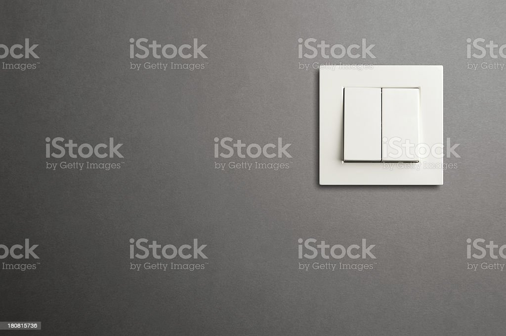 Electric switch in on gray wall stock photo