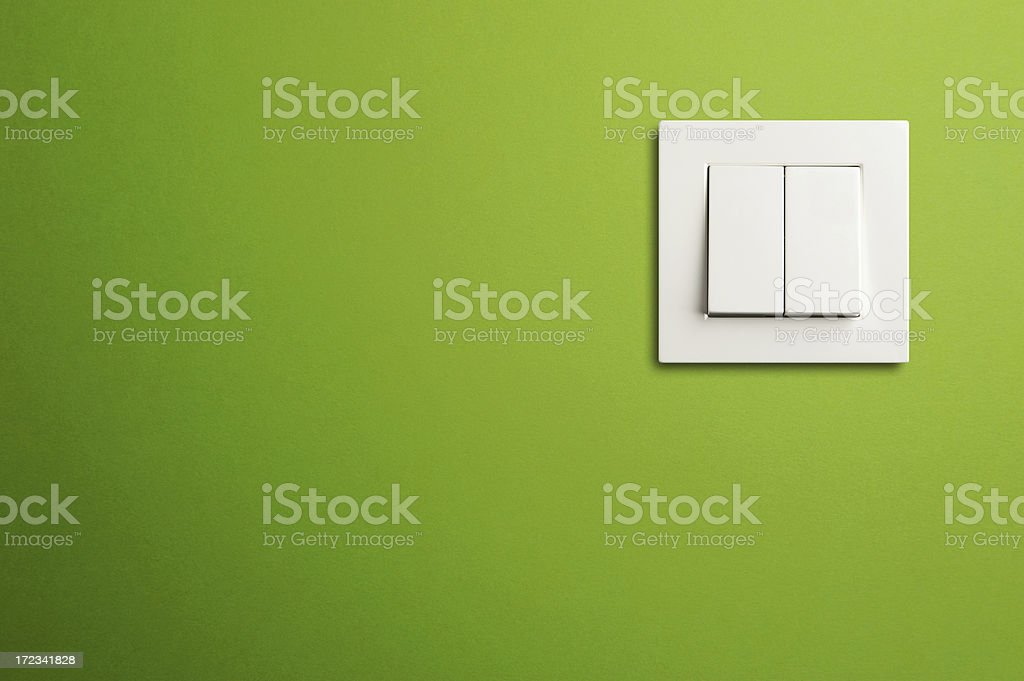 Electric switch in on green wall stock photo