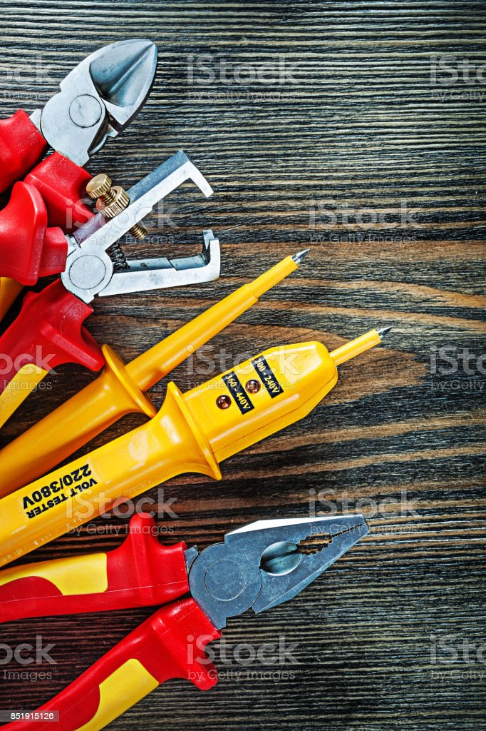 Electric tester insulation strippers cutting nippers pliers on w stock photo