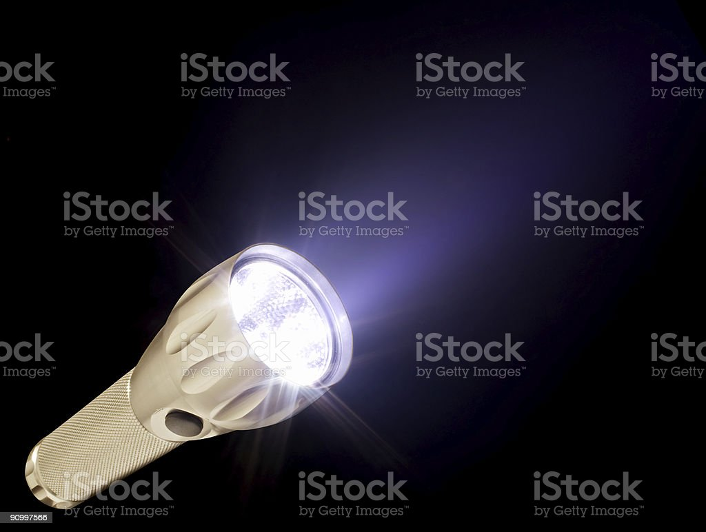 Electric torch and beam in the dark, isolated on black royalty-free stock photo