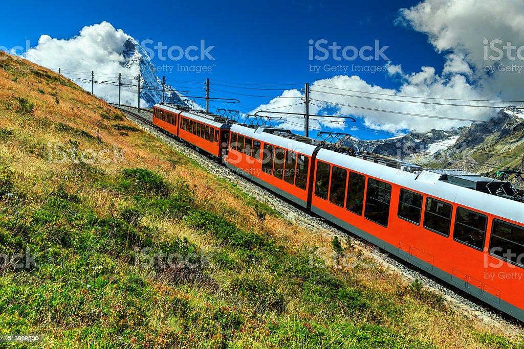 Electric tourist train and famous misty Matterhorn peak,Switzerland,Europe stock photo