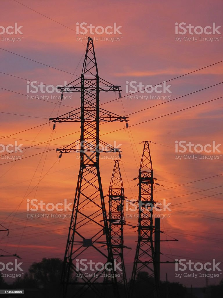 electric towers and cables on summer sundown royalty-free stock photo