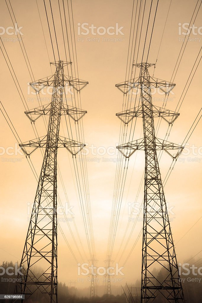 Electric towers. Sepia toned background stock photo