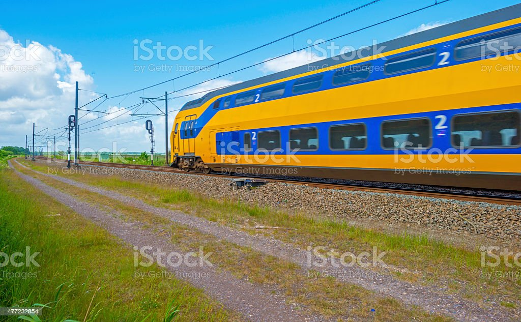 Electric train driving through nature in spring stock photo