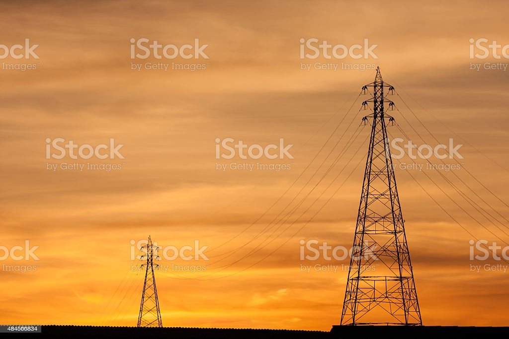 Electric Transmission Towers in orange sunset. stock photo
