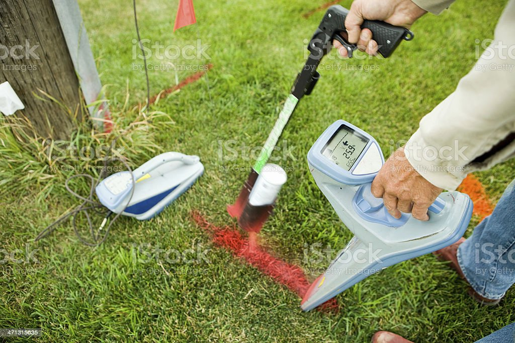 Electric Utility Locator Using Radio Frequency Detector to Mark Line stock photo