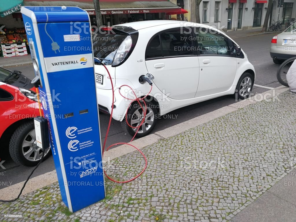Berlin, Germany - April 27, 2017: electric vehicle being charged at Vattenfall charging station stock photo