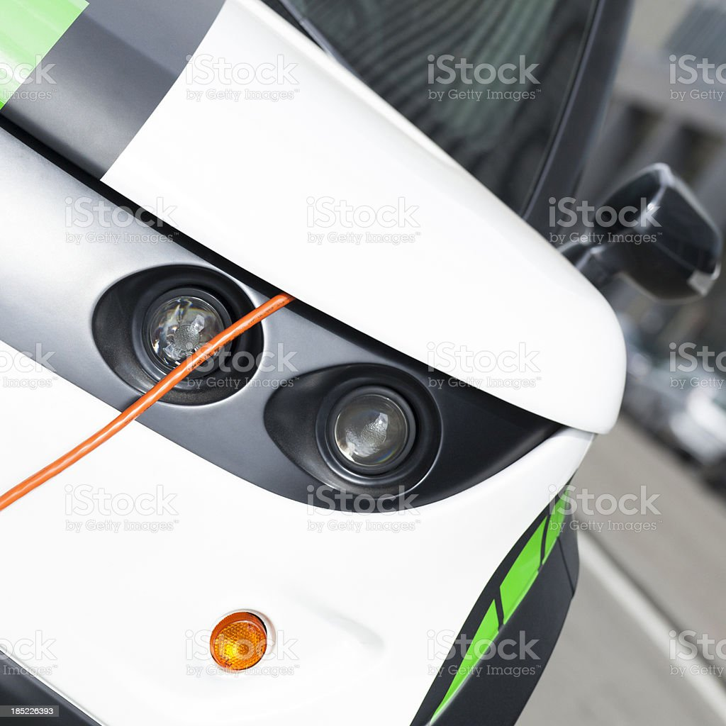 Electric vehicle charging royalty-free stock photo