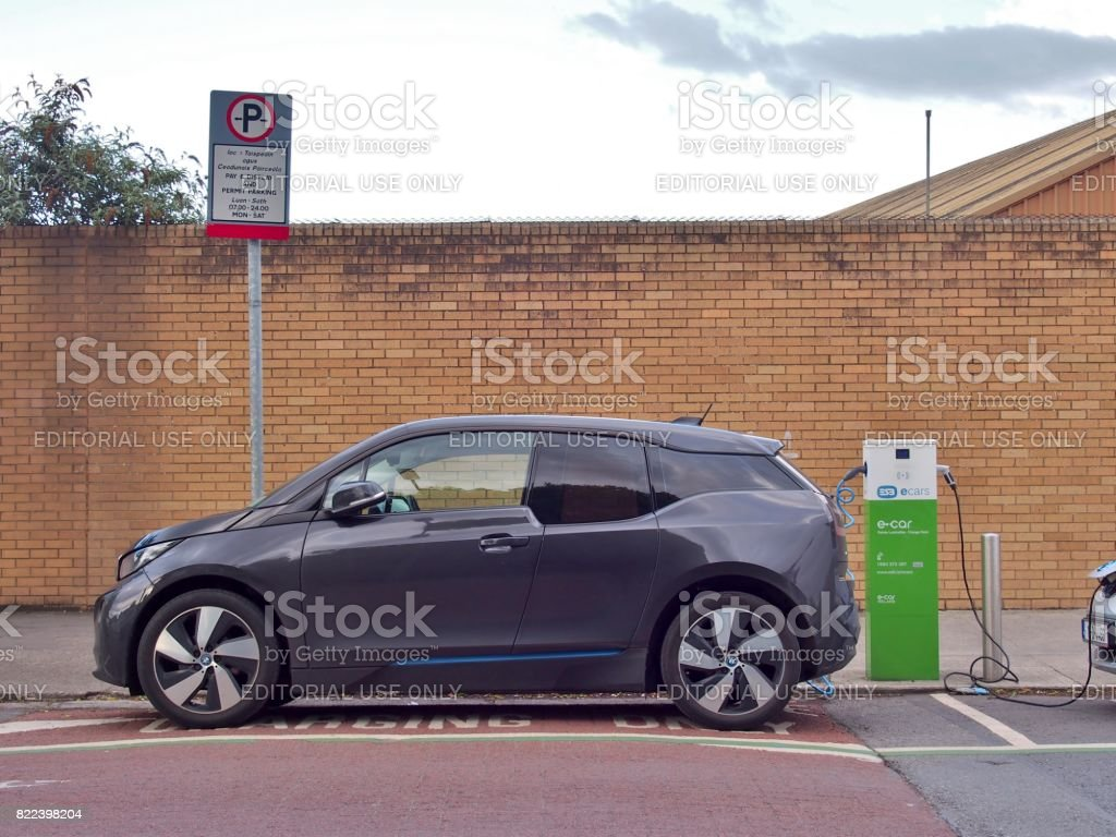 Electric Vehicle 'EV' charging electric power at public charge point. stock photo