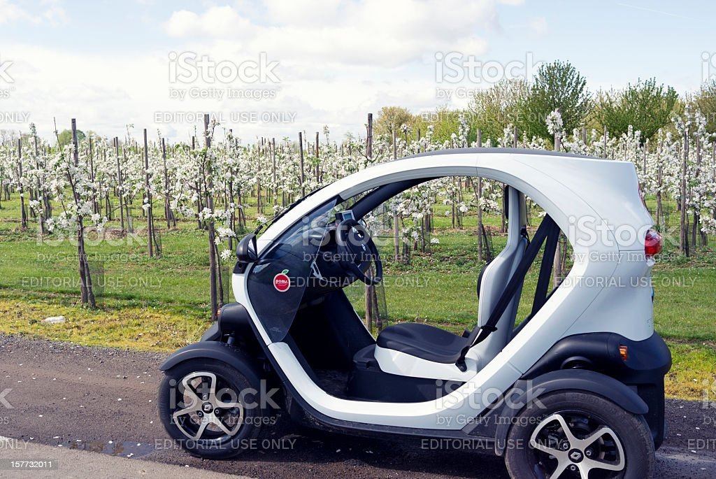 Electric vehicle Renault Twizy 45 stationary on  rural road, Belgium stock photo