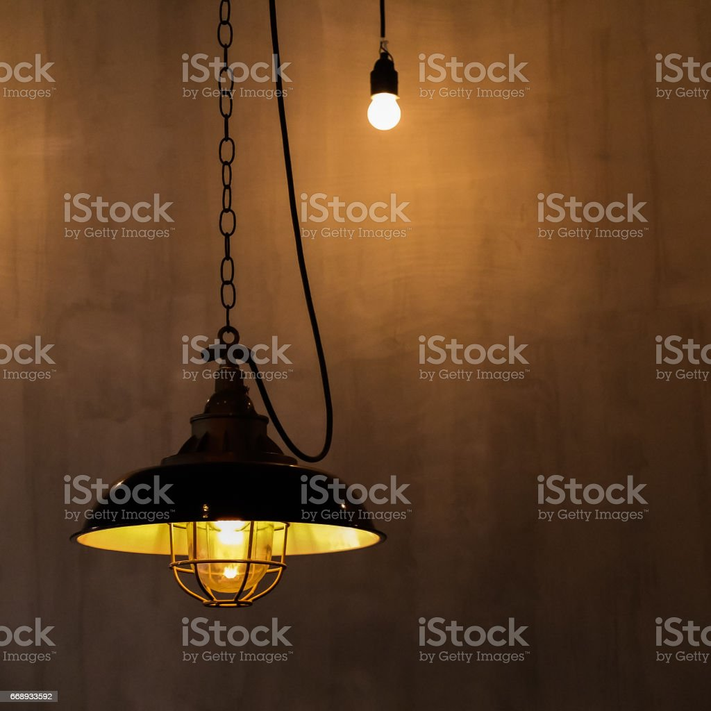 Electric vintage lamp hanging from the ceiling stock photo