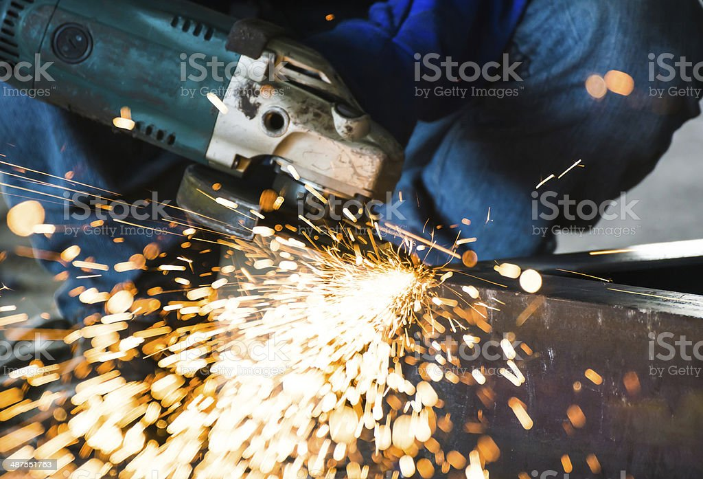 Electric wheel grinding on steel structure construction plant stock photo