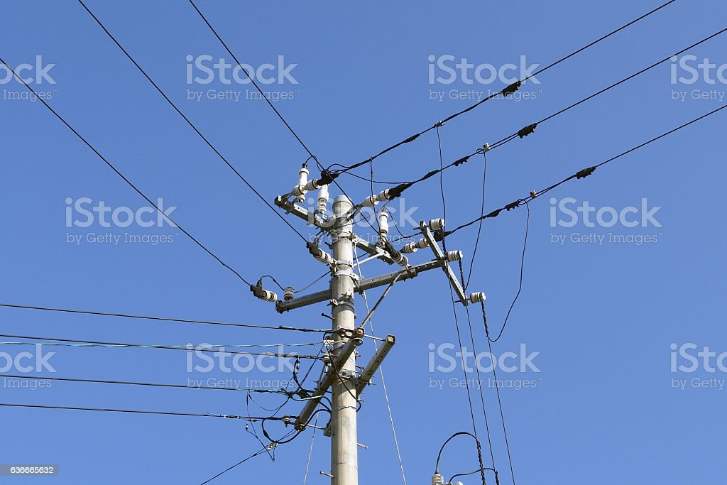 Electric wires and telephone poles stock photo