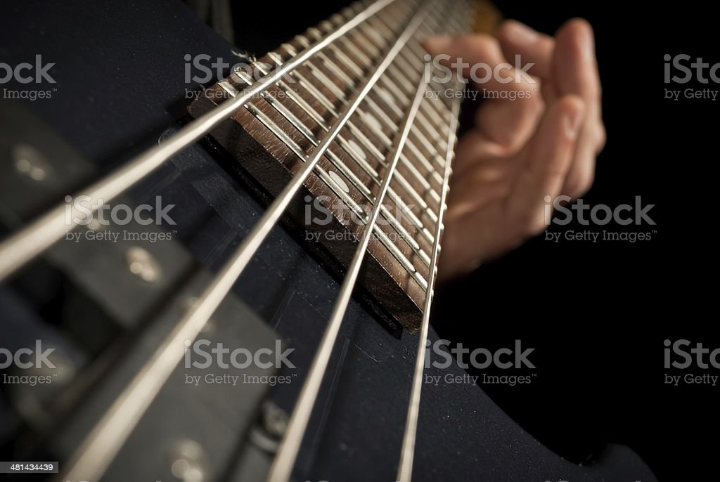 electrical bass guitar strings with fingers stock photo