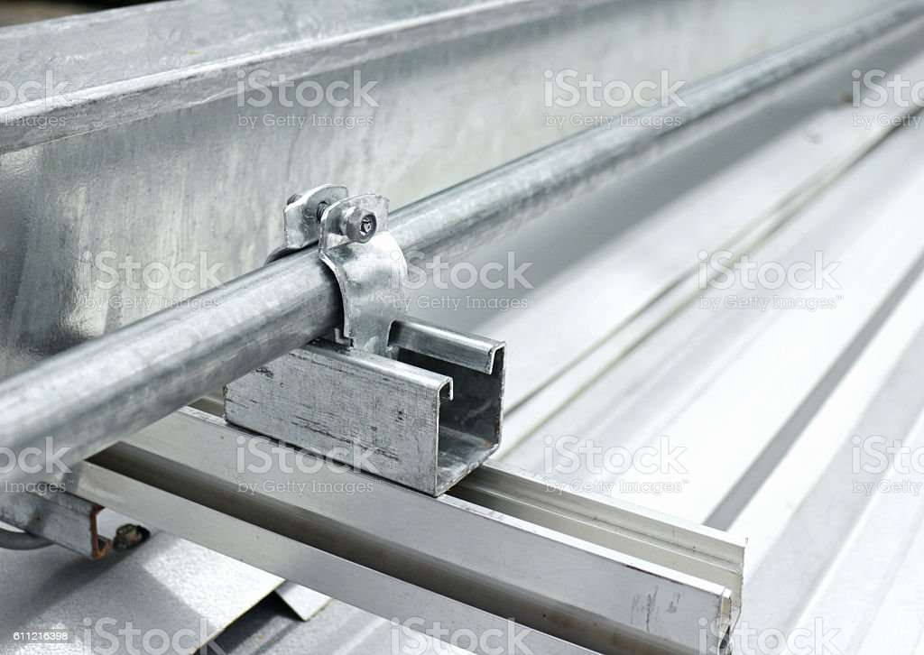 Electrical Conduit Installation on Roof stock photo