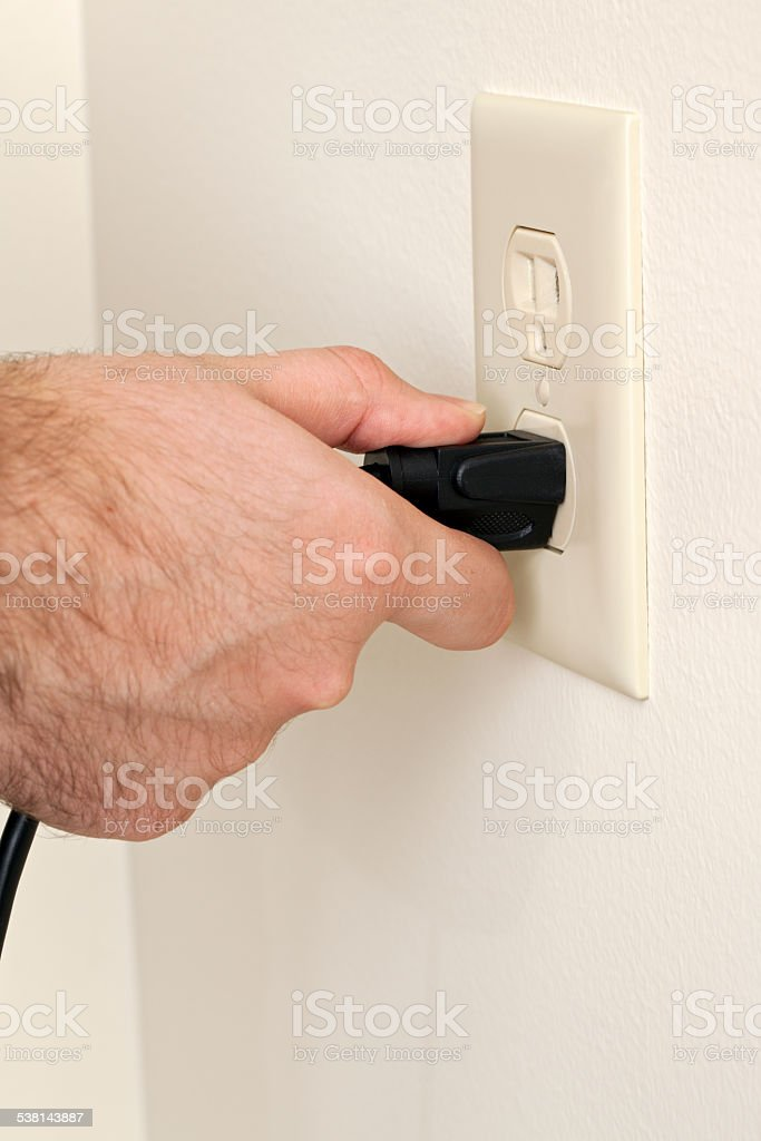 Electrical Cord in Outlet stock photo