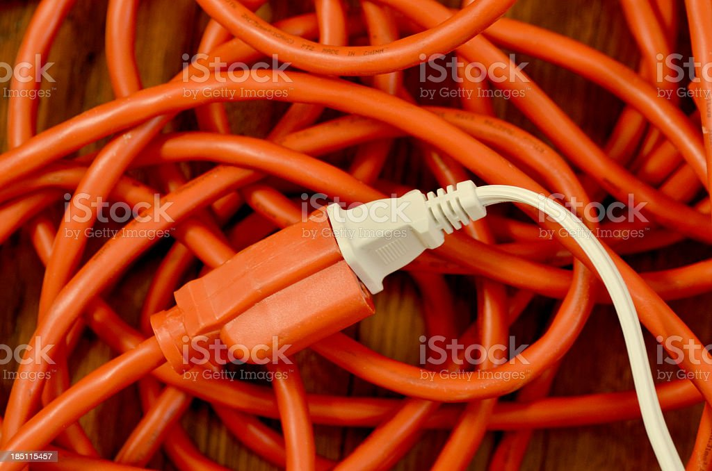 Electrical Cord Plugged Into Extension Cord stock photo