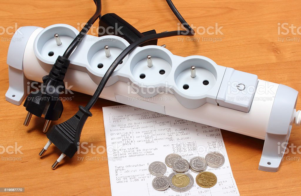 Electrical cords disconnected from power strip, electricity bill stock photo