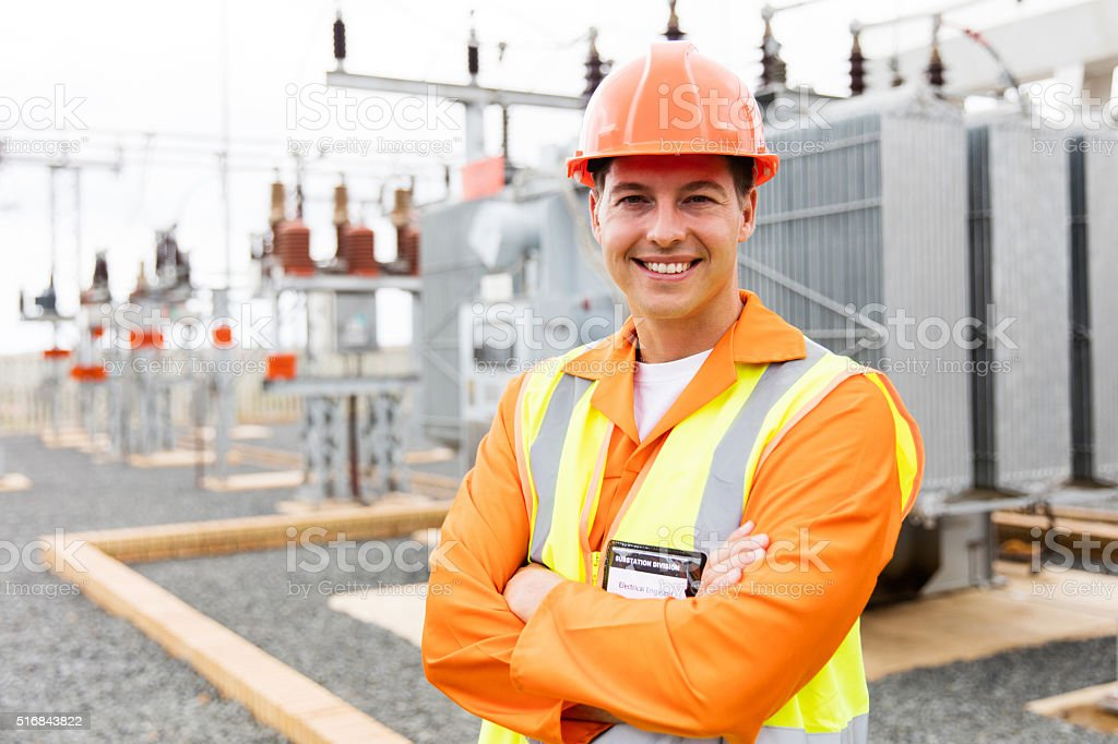 electrical engineer arms crossed stock photo