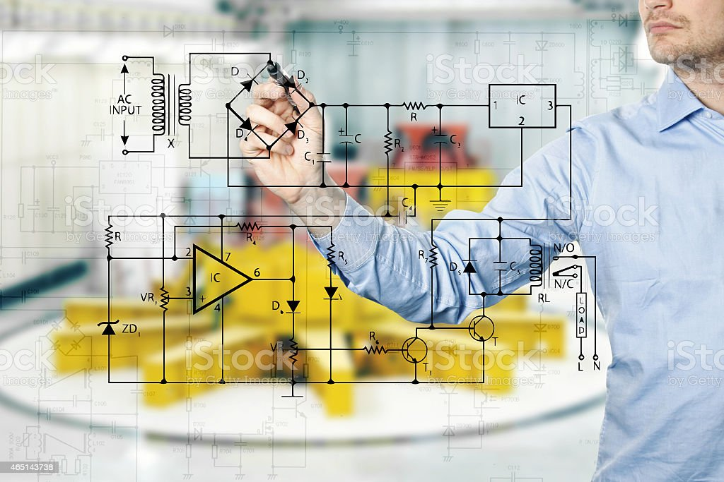 electrical engineer draws a diagram of a circuit stock photo