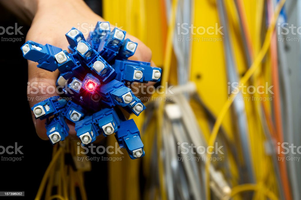 Electrical engineer holding a bunch of fiber optics stock photo