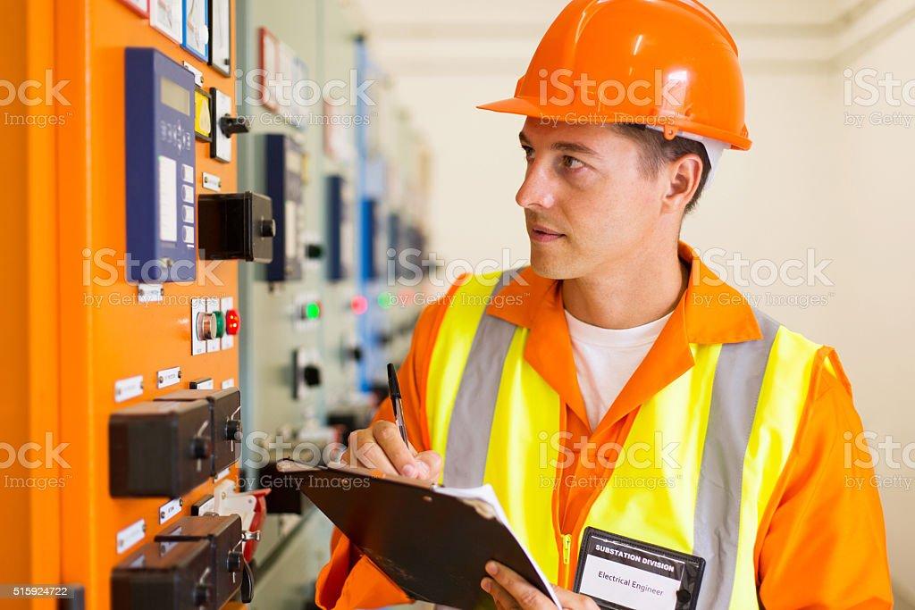 electrical engineer taking machine readings stock photo