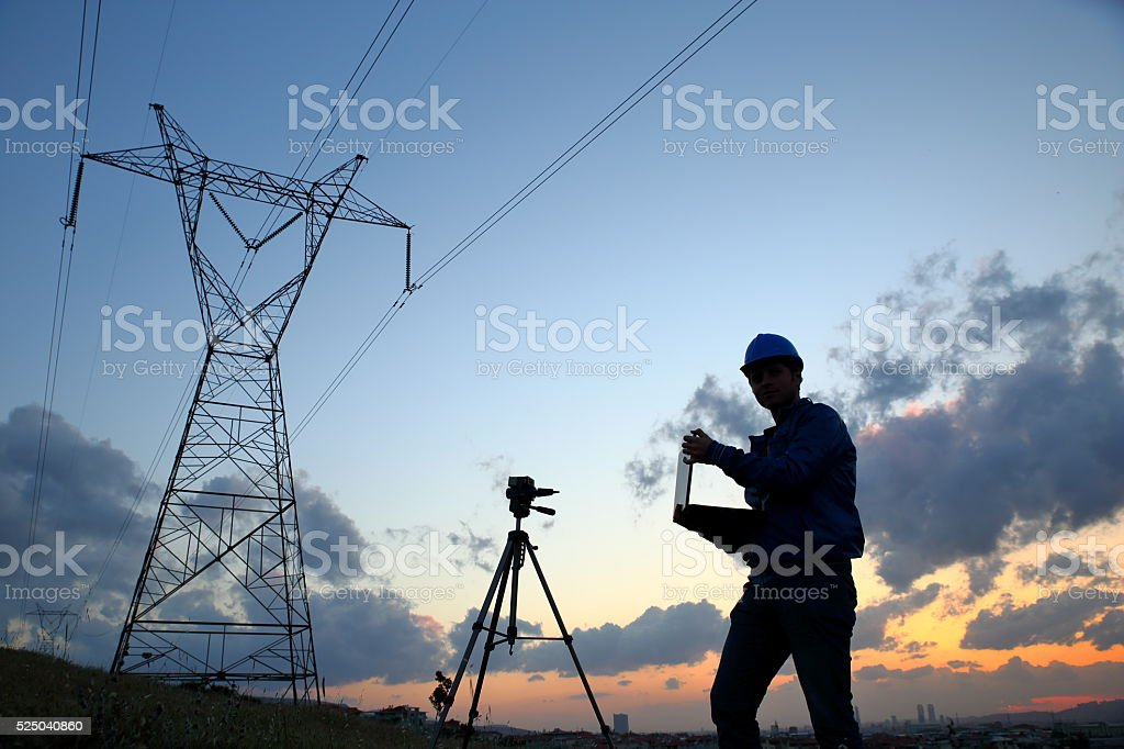 Electrical engineer while working laptop stock photo
