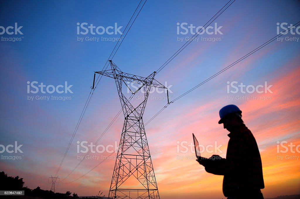 Electrical engineer while working laptopl stock photo