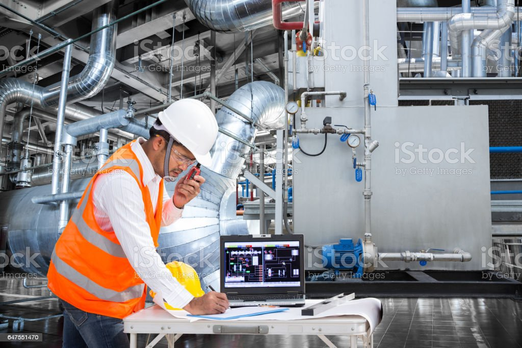 Electrical engineer working at control room of thermal power plant stock photo