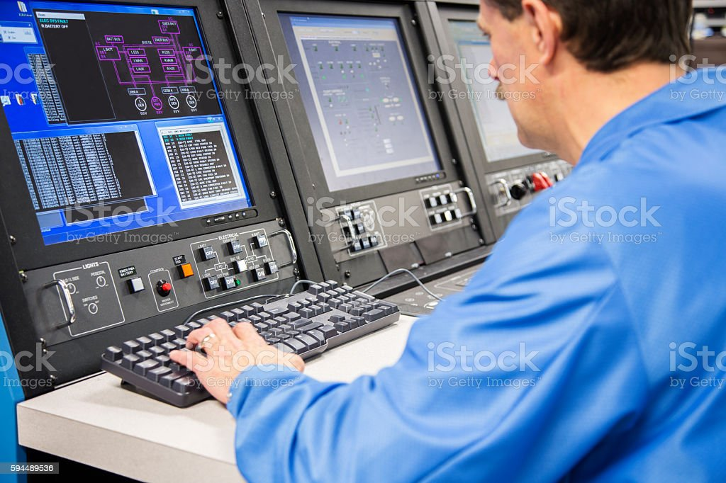 Electrical Engineer working in lab developing aircraft electronics stock photo