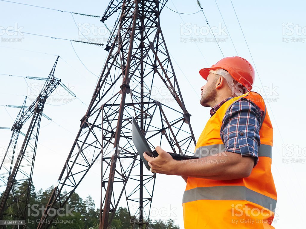 Electrical engineer working. Talking on the phone and working wo stock photo
